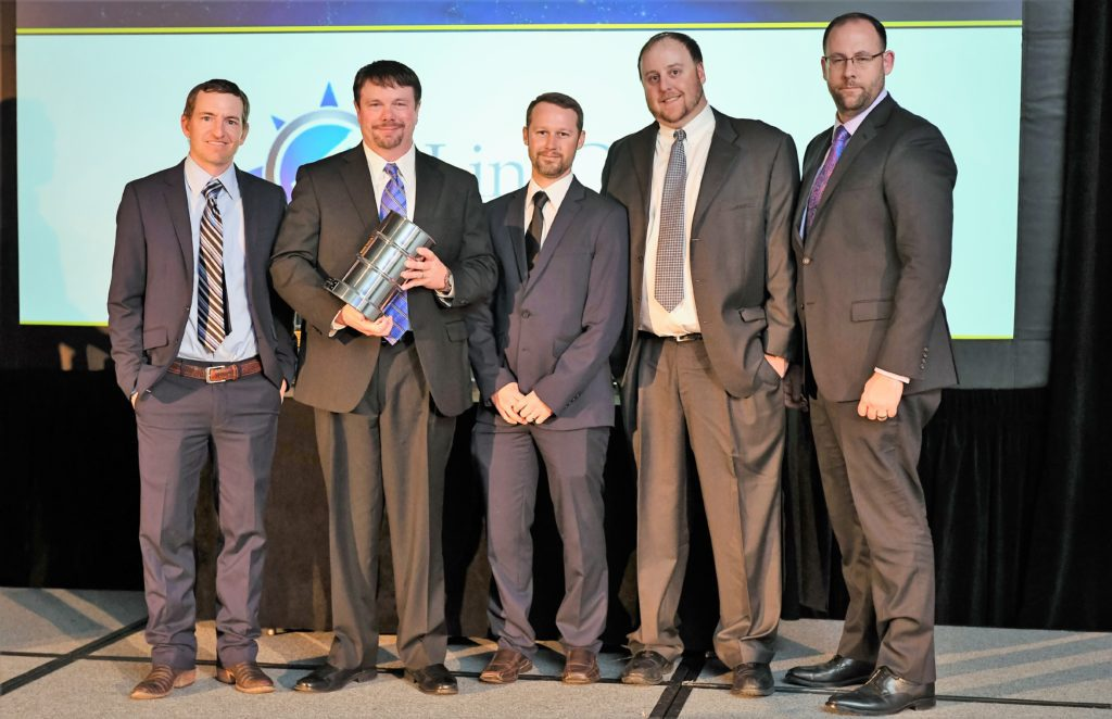 LineQuest receiving Oilfield Services Company of the Year Award